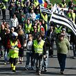 "Yellow Vests (""gilets jaunes"") protesters hold Britany flags as they take part in an anti-government demonstration on March 23, 2019 in Saint-Brieuc, western France. - Demonstrators hit French city streets again on March 23, for a 19th consecutive week of nationwide protest against the French President's policies and his top-down style of governing, high cost of living, government tax reforms and for more ""social and economic justice."" (Photo by Fred TANNEAU / AFP)"