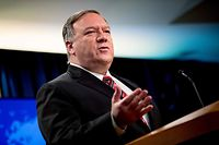 """(FILES) In this file photo US Secretary of State Mike Pompeo pauses while speaking at a news conference at the State Department on April 29, 2020, in Washington,DC. - US Secretary of State Mike Pompeo said May 3, 2020 that there was """"enormous evidence"""" that the coronavirus pandemic originated in a laboratory in Wuhan, China. """"There is enormous evidence that this is where it began,"""" he said on ABC's """"This Week.""""But while highly critical of China's handling of the matter, Pompeo declined to say whether he thought the virus had been intentionally released. (Photo by Andrew Harnik / POOL / AFP)"""