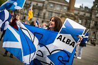 Pro-independence protesters gather in George Square, Glasgow on May 1, 2021, ahead of the upcoming Scottish Parliament election which is to be held on May 6, 2021. - Questions remain over whether Scots will back independence in a referendum after all the SNP infighting, with a string of surveys showing waning popular support for breaking away from the UK. (Photo by Andy Buchanan / AFP)