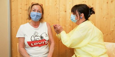 52-year-old health minister Lenert receiving her first vaccine dose