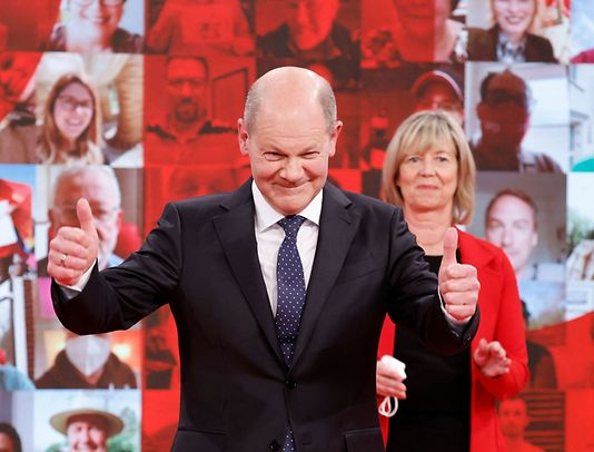 German Social Democratic Party (SPD) candidate for chancellor Olaf Scholz gives the thumbs up on stage during a party meeting in Berlin, on May 9, 2021.