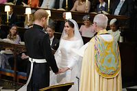 Britain's Prince Harry, Duke of Sussex, and US fiancee of Britain's Prince Harry Meghan Markle during their wedding ceremony in St George's Chapel, Windsor Castle, in Windsor, on May 19, 2018. / AFP PHOTO / POOL / Dominic Lipinski