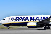 (FILES) In this file photo taken on March 30, 2019 An airliner bearing the Ryanair Irish low-cost airline livery taxies on the tarmac on March 30, 2019 at Rome's Fiumicino airport. - British Airways and Ireland's Ryanair on Monday announced major flight cancellations particularly to Italy, in response to the worsening novel coronavirus outbreak, while Germany's Lufthansa  extended cutbacks. (Photo by Andreas SOLARO / AFP)