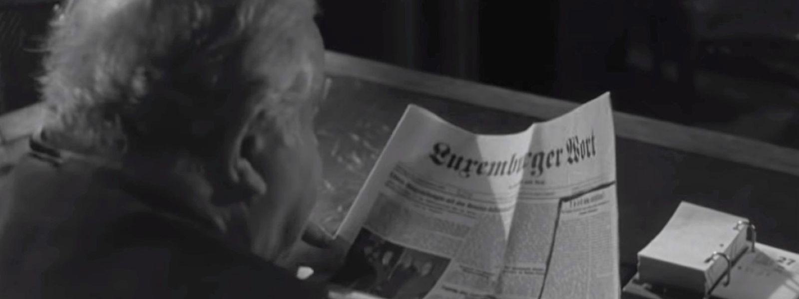 Joseph Bech beim Zeitung lesen.