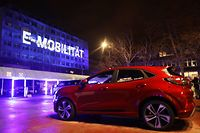 "A building of the assembly plant of US car maker Ford is illuminated with the lettering 'E-Mobilitaet' (E-Mobility) in Cologne, western Germany, on February 17, 2021. - US auto giant Ford said on February 17, 2021 it was investing one billion dollars in Germany in a bid to make all of its passenger vehicles sold in Europe electric by 2030. The company said in a statement that ""by mid-2026, 100 percent of Ford's passenger vehicle range in Europe will be zero-emissions capable, all-electric or plug-in hybrid, and will be completely all-electric by 2030"". It said it would upgrade its assembly plant in Cologne, the home of Ford Europe, with a USD 1-billion (830-million-euro) investment to advance the company's ""all-electric future"". (Photo by Oliver Berg / POOL / AFP)"