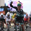 Ireland's Sam Bennett celebrates as he crosses the finish line at the end of the 200km 3rd stage of the 77th Paris-Nice cycling race stage between Cepoy and Moulins/Yzeure in Moulins on March 12, 2019. (Photo by Anne-Christine POUJOULAT / AFP)