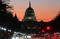 WASHINGTON, DC - MARCH 23: The early morning sun begins to rise behind the U.S. Capitol on March 23, 2017 in Washington, DC. House Republicans are trying to secure enough support to vote on repealing and replacing the Affordable Care Act or Obamacare.   Mark Wilson/Getty Images/AFP == FOR NEWSPAPERS, INTERNET, TELCOS & TELEVISION USE ONLY ==