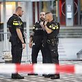 Police stand during the evacuation the Maassilo concert venue after a concert by Californian ban Allah-Las was canceled in relation to a terror attack threat, according to police and the venue, on August 23, 2017, in Rotterdam. / AFP PHOTO / ANP / Arie Kievit / Netherlands OUT