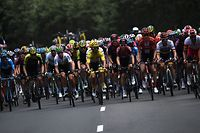 (FILES) In this file photo taken on July 14, 2019 France's Julian Alaphilippe, wearing the overall leader's yellow jersey (C) rides in the pack during the ninth stage of the 106th edition of the Tour de France cycling race between Saint-Etienne and Brioude. - The Tour de France is not only a French monument, but also the economic heartbeat of professional cycling itself and analysts fear heavy consequences if the coronavirus crisis forces its cancellation. An announcement is expected this week on either a postponement or an outright cancellation of the 21-day extravaganza that is currently scheduled to start in Nice on June 27. (Photo by JEFF PACHOUD / AFP)