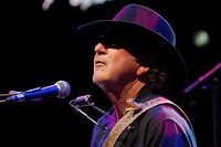 In this picture made available Sunday July 21, 2013 American blues and rock singer and guitarist Tony Joe White performs on the Auditorium Stravinski, during the 47th Montreux Jazz Festival, in Montreux, Switzerland, Saturday July 20, 2013.  (AP Photo/Keystone, Sandro Campardo)