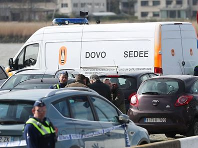 Police officers and and Sedee-Dovo, the mine clearance service of Belgian defence, patrol  in Antwerp where police arrested a man