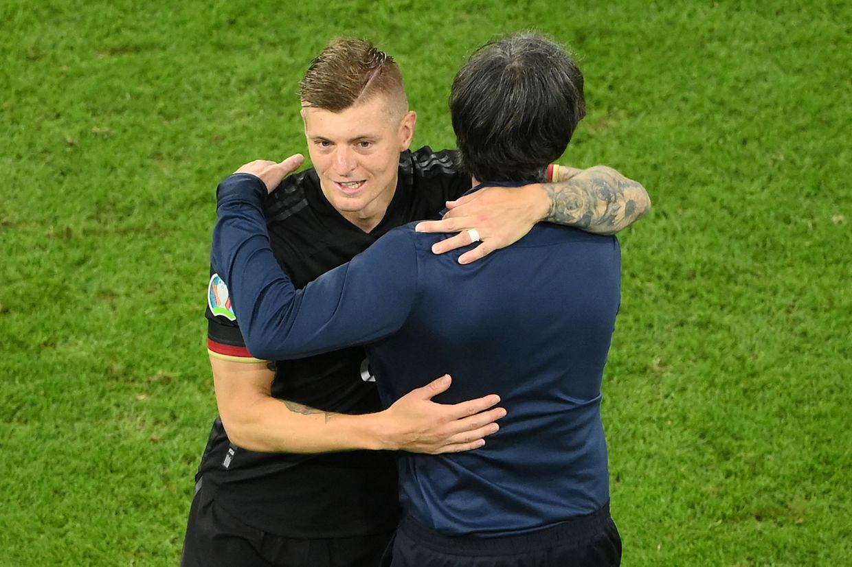 TOPSHOT - Germany's coach Joachim Loew and Germany's midfielder Toni Kroos embrace after the UEFA EURO 2020 Group F football match between Germany and Hungary at the Allianz Arena in Munich on June 23, 2021. (Photo by Matthias Hangst / POOL / AFP)