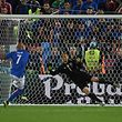 Italy's forward Simone Zaza (L) misses a penalty during a penalty shootout of the Euro 2016 quarter-final football match between Germany and Italy at the Matmut Atlantique stadium in Bordeaux on July 2, 2016.  / AFP PHOTO / PATRIK STOLLARZ