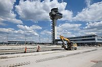 A picture taken on July 14, 2020 shows workers at the Berlin Brandenburg Airport (BER) Schoenefeld Airport construction site near Berlin during a press visit on July 14, 2020. (Photo by Tobias SCHWARZ / AFP)