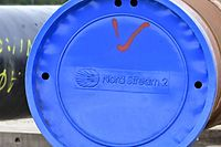 (FILES) In this file photo taken on March 26, 2019 a pipe is seen at the construction site of the Nord Stream 2 gas pipeline in Lubmin, northeastern Germany. - The US said on July 21, 2021, it had reached an agreement with Germany on the controversial Nord Stream 2 pipeline that would threaten Russia with sanctions and seek to extend the transit of gas through Ukraine. (Photo by Tobias SCHWARZ / AFP)