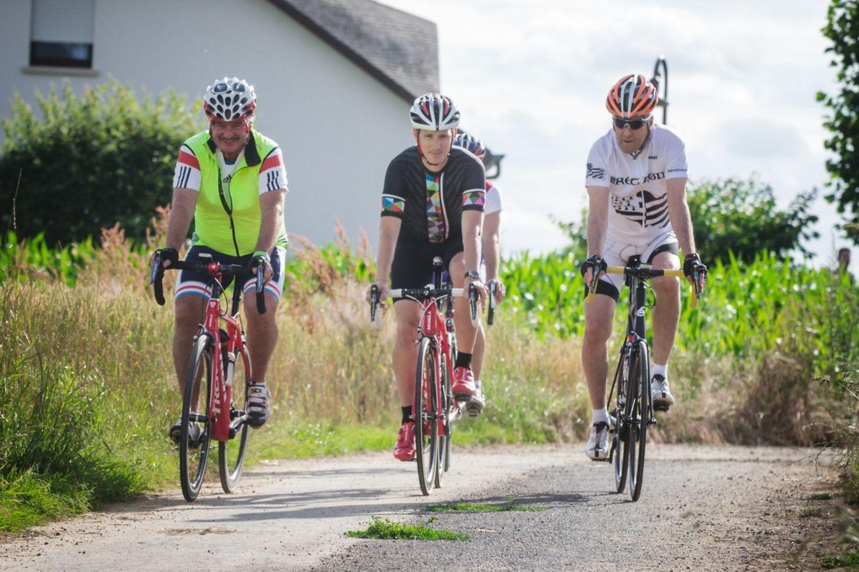 US-Außenminister John Kerry mit Jean Asselborn und Andy Schleck bei einer Radtour durch Steinfort.
