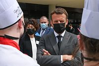 French President Emmanuel Macron talks with students at the Hospitality school in Tain l'Hermitage on June 8, 2021 during a visit in the south eastern France department of Drome, the second stage of a nationwide tour ahead of next year's presidential election. (Photo by PHILIPPE DESMAZES / AFP)