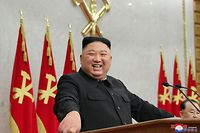 """This picture taken on February 8, 2021 and released from North Korea's official Korean Central News Agency (KCNA) on February 9 shows North Korean leader Kim Jong Un attending the first day of the 2nd plenary meeting of the 8th Central Committee of the Workers' Party of Korea (WPK) in North Korea. (Photo by STR / KCNA VIA KNS / AFP) / - South Korea OUT / REPUBLIC OF KOREA OUT   ---EDITORS NOTE--- RESTRICTED TO EDITORIAL USE - MANDATORY CREDIT """"AFP PHOTO/KCNA VIA KNS"""" - NO MARKETING NO ADVERTISING CAMPAIGNS - DISTRIBUTED AS A SERVICE TO CLIENTS THIS PICTURE WAS MADE AVAILABLE BY A THIRD PARTY. AFP CAN NOT INDEPENDENTLY VERIFY THE AUTHENTICITY, LOCATION, DATE AND CONTENT OF THIS IMAGE. /"""