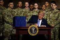 US President Donald Trump signs the �John S. McCain National Defense Authorization Act for Fiscal Year 2019� at Fort Drum, New York, on August 13, 2018. (Photo by Brendan Smialowski / AFP)
