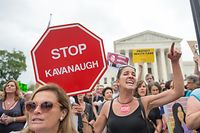 Demonstrators shout as they protest against the appointment of Supreme Court nominee Brett Kavanaugh at the Supreme Court in Washington DC, on October 6, 2018. - The US Senate confirmed conservative judge Kavanaugh as the next Supreme Court justice on October 6, offering US President Donald Trump a big political win and tilting the nation's high court decidedly to the right. (Photo by ROBERTO SCHMIDT / AFP)