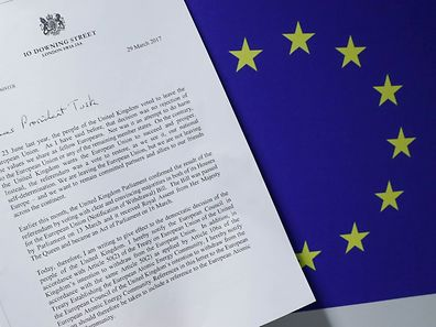 A copy of British Prime Minister Theresa May's Brexit letter in notice of the UK's intention to leave the bloc under Article 50 of the EU's Lisbon Treaty, is placed next to a European Flag in this March 29, 2017 photo illustration. REUTERS/Yves Herman /Photo Illustration