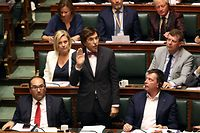 Belgiums's Socialist Party chairman Elio Di Rupo (C) takes the oath during a ceremony at the installation of the Chamber after last month's federal elections, in Brussels on June 20, 2019. 150 citizens take the oath to become members of the Chamber for the 2019-2024 legislature. - The Belgian Liberal leader who presided today the installation of the Chamber of Deputies renewed in late May, has decided not to step on the perch refusing to be attended by a very controversial right-wing MP, during this solemn meeting. (Photo by VIRGINIE LEFOUR / BELGA / AFP) / Belgium OUT