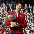 Tennis - French Open Men's Singles Final match - Roland Garros - Novak Djokovic of Serbia v Andy Murray of Britain - Paris, France - 05/06/16. Djokovic celebrates with the trophy after winning.      REUTERS/Jacky Naegelen