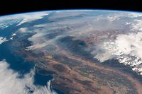 "This handout picture obtained from the European Space Agency (ESA) on August 7, 2018 shows a view taken by German astronaut and geophysicist Alexander Gerst, showing wildfires in the state of California as seen from the International Space Station on August 2, 2018.  / AFP PHOTO / EUROPEAN SPACE AGENCY / Alexander GERST / RESTRICTED TO EDITORIAL USE - MANDATORY CREDIT ""AFP PHOTO / ESA / Alexander Gerst"" - NO MARKETING NO ADVERTISING CAMPAIGNS - DISTRIBUTED AS A SERVICE TO CLIENTS"