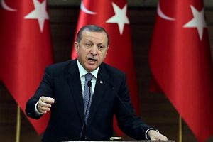 """Turkish President Recep Tayyip Erdogan delivers a speech during a meeting of """"mukhtars"""" (heads of towns and villages) at the Presidential Complex in Ankara on February 24, 2016. / AFP / ADEM ALTAN"""