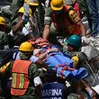A man is pulled out of the rubble alive in Mexico City on September 20, 2017 as the search for survivors continues a day after a strong quake hit central Mexico. A powerful 7.1 earthquake shook Mexico City on Tuesday, causing panic among the megalopolis' 20 million inhabitants on the 32nd anniversary of a devastating 1985 quake. / AFP PHOTO / Pedro PARDO