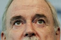 British comedian and film star John Cleese pauses during his keynote address to a conference in Sydney, Friday, Oct 13, 2006. Cleese has cancelled his one-man show in Australia after deciding he did not like to work alone. (AP Photo/Mark Baker)