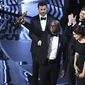"89th Academy Awards - Oscars Awards Show - Hollywood, California, U.S. - 26/02/17 - Writer and Director Barry Jenkins of ""Moonlight"" holds up the Best Picture Oscar in front of host Jimmy Kimmel (rear) as he stands with Producer Adele Romanski (R). REUTERS/Lucy Nicholson"