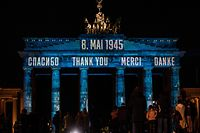 """A projection reading """"thank You"""" in Russian, English, French and German is projected on Berlin's Brandenburg Gate on May 8, 2020, on the 75th anniversary of the end of World War Two. - The May 8 anniversary of Nazi Germany's unconditional surrender to the Allies is a one-off public holiday in Berlin this year, although events have been scaled down because of the coronavirus pandemic. (Photo by John MACDOUGALL / AFP)"""