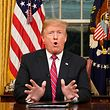 "US President Donald Trump delivers a televised address to the nation on funding for a border wall from the Oval Office of the White House in Washington DC on January 8, 2019. - Trump demanded $5.7 billion to fund a wall on the US-Mexico border in his first televised Oval Office address Tuesday, describing a ""growing crisis"" of illegal immigration hurting millions of Americans. The president stopped short of calling for a much-touted state of emergency, instead appealing to the need to slash the cost of the illegal drug trade, which he put at $500 billion a year. ""There is a growing humanitarian and security crisis at our southern border. Every day customs and border patrol agents encounter thousands of illegal immigrants trying to enter our country,"" Trump said. (Photo by CARLOS BARRIA / POOL / AFP)"