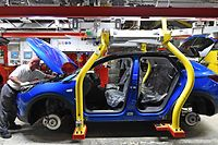 """(FILES) In this file photo taken on August 28, 2019, a man works on the assembling of an Opel """"Grandland X"""" SUV car at Opel's plant in Eisenach, eastern Germany. - Peugeot subsidiary Opel said on January 14, 2020 it would offer 2,100 more German workers voluntary redundancies, as it struggles to stay afloat faced with collapsing demand and an EU emissions squeeze. (Photo by Martin Schutt / dpa / AFP) / Germany OUT"""