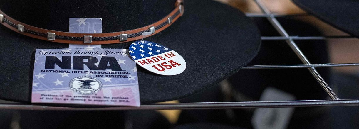 "(FILES) In this file photo taken on July 22, 2020, a NRA sign is seen on a Stetson hat displayed at the manufacture store, in Garland, Texas. - The state of New York announced on August 6, 2020, it was suing the National Rifle Association and its leader Wayne LaPierre for financial fraud and misconduct, aiming to dissolve the powerful conservative lobby. ""The NRA's influence has been so powerful that the organization went unchecked for decades while top executives funneled millions into their own pockets,"" said state Attorneya General Letitia James. (Photo by VALERIE MACON / AFP)"