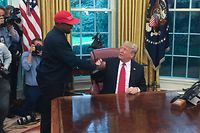 US President Donald Trump meets with rapper Kanye West in the Oval Office of the White House in Washington, DC, October 11, 2018. (Photo by SEBASTIAN SMITH / AFP)