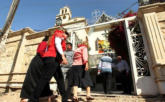 Churches in Iraq are not like churches in Luxembourg, however. Most of them are surrounded by concrete walls to stop armed attacks