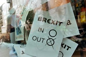"A poster featuring a Brexit vote ballot with ""out"" tagged is on display at a book shop window in Berlin on June 24, 2016.  Britain has voted to break out of the European Union, striking a thunderous blow against the bloc and spreading panic through world markets on June 24 as sterling collapsed to a 31-year low.  / AFP PHOTO / John MACDOUGALL"