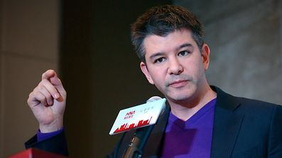(FILES) This file photo taken on January 11, 2016 shows Travis Kalanick, CEO of the global ridesharing service Uber, during a press conference in Beijing  Kalanick stepped down as CEO on June 20, 2017, under preassure from major investors, according to media reports.  / AFP PHOTO / WANG Zhao