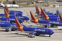 (FILES) In this file photo taken on March 28, 2019 (FILES) Southwest Airlines Boeing 737 MAX aircraft are parked on the tarmac after being grounded, at the Southern California Logistics Airport in Victorville, California. - The shutdown of Boeing production lines for the grounded 737 MAX continued to undercut US industrial output in January, which declined for the second consecutive month, the Federal Reserve reported February 14, 2020. A boost in auto manufacturing partly offset the drop in aircraft output, but unusually mild weather meant utilities fell for the second straight month as well, according to the monthly data report. (Photo by Mark RALSTON / AFP)