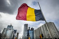 The Belgian flag flying at half-mast is pictured at the Hofplein in Rotterdam, on March 23, 2016, one day after some 35 people were killed in bombings at Zaventem Airport and on a metro train.  / AFP / ANP / Lex van Lieshout / Netherlands OUT        (Photo credit should read LEX VAN LIESHOUT/AFP/Getty Images)