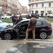 The black Alfa Romeo used by a man suspected of wounding several foreign nationals in a drive-by shooting,is blocked by police and Carabibieri enforcement at Macerata, on  February 3, 2018 Italian police said they have arrested a man suspected of opening fire on foreigners from a vehicle in central Italy on February 3, 2018. Media reported six people were injured, four of them seriously, in the incident in the town of Macerata.   / AFP PHOTO / STR