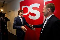 New Socialist party Chairman Paul Magnette (R) shakes hands with former PS chairman Elio Di Rupo on October 20, 2019, in the headquarters in Brussels. (Photo by NICOLAS MAETERLINCK / BELGA / AFP) / Belgium OUT