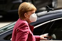 German Chancellor Angela Merkel, wearing a face mask, arrives by car for talks of the conservative Christian Democratic Union (CDU) party and its Bavarian affiliate Christian Social Union (CSU) at the Reichstag building in Berlin on April 11, 2021, in view of the September general elections. - With less than six months to go until a general election and their poll ratings plummeting, German Chancellor Merkel's conservatives are meeting for crunch talks on April 11 as pressure builds to pick their chancellor candidate. (Photo by Tobias SCHWARZ / AFP)