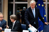 European Union's chief Brexit negotiator Michel Barnier (R) arrives for a meeting at the European Parliament in Brussels, on October 16, 2019. (Photo by Kenzo TRIBOUILLARD / AFP)
