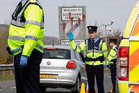 (FILES) In this file photo taken on April 09, 2020 Irish Police (Garda) stop and check vechicles at the border crossing at Carrkcarnon, County Louth, Ireland, on April 9, 2020 under new powers to curb non-essential travel during the coronavirus crisis. - Britain held emergency talks with the European Union on September 10, 2020, facing warnings of legal action over a new Brexit bill and a threatening reminder of its obligations to Northern Ireland from powerful US Democrat Nancy Pelosi. (Photo by PAUL FAITH / AFP)