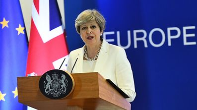 British Prime Minister Theresa May addresses a press conference at the end of a European Council meeting, on the second day of a summit of European Union (EU) leaders at the European Union headquarters in Brussels, on June 23, 2017.  / AFP PHOTO / EMMANUEL DUNAND