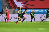 Wolfsburg's German midfielder Maximilian Arnold (R) celebrates scoring the 0-2 during the German first division Bundesliga football match Bayer 04 Leverkusen v VfL Wolfsburg on May 26, 2020 in Leverkusen, western Germany. (Photo by Marius Becker / POOL / AFP) / DFL REGULATIONS PROHIBIT ANY USE OF PHOTOGRAPHS AS IMAGE SEQUENCES AND/OR QUASI-VIDEO