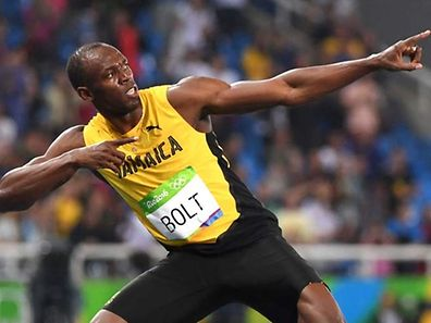 "TOPSHOT - Jamaica's Usain Bolt does his ""Lightening Bolt""pose after he won the Men's 200m Final during the athletics event at the Rio 2016 Olympic Games at the Olympic Stadium in Rio de Janeiro on August 18, 2016.   / AFP PHOTO / OLIVIER MORIN"